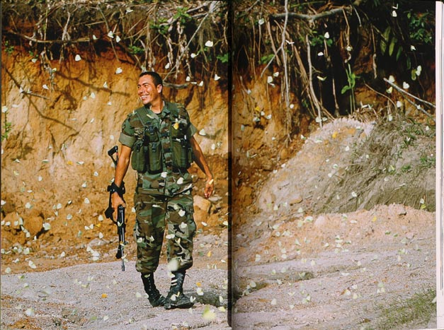 Colombian army soldier surrounded by yellow butterflies.